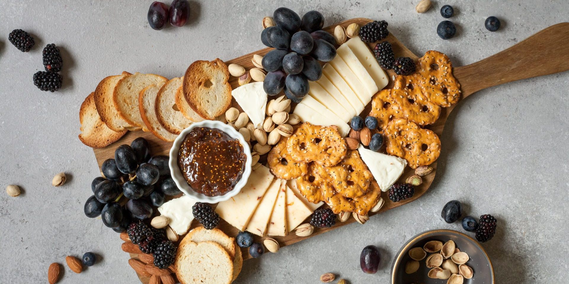Cheese, fruit, bread platter